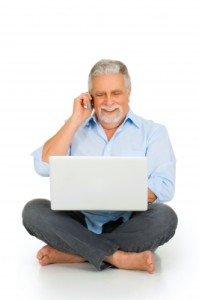 ambro older man on laptop and cell phone